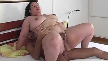 Mature sexy woman with big Tits and ass hotly Fucks with a young guy.