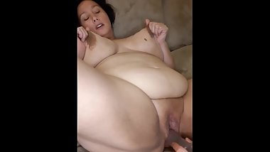 Slutty MILF being fucked by dildo and playing with her big breasts