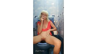 Angel Fowler AS A REAL SLUT SMOKING AND PISSING IN PUBLIC TOILET